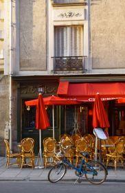 Bike in front of empty cafe, Paris